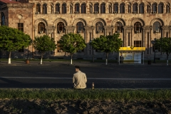 A man sits in a corner alone. He is one of the demonstrators waiting for his friends. Police officers cleared the streets from demonstrators. April 15, 2018, Yerevan-Armenia.
