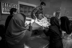 The hospital staff and nurses attempt to move his body from I.C.U to the operating room, to prepare him for the operation.(Donating his body parts).In a hospital in Tehran. 21 Jan 2014.