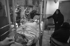 The brain dead person along with his family during the transfer of his body to the operation room for the donating his body parts.A bitter yet beautiful moment of giving life to others.In hospital in Tehran, Jan 2014.